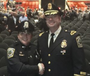 Officer Joanne Ballard and Chief Donald Cudmore of the Georgetown Police Department at the 3rd ROC Academy Class in Plymouth graduation at Brockton High School.