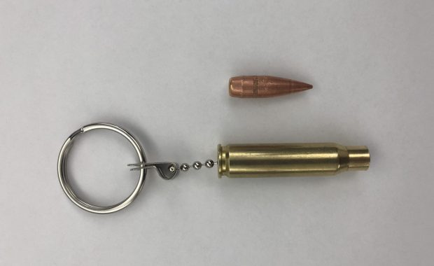 The real slug (top) was attached to an empty brass casing and made into a keychain that was owned by a student at the Byam Elementary School in Chelmsford. Officials have discussed the appropriateness of such a keychain with the student after the slug broke off on Wednesday and was found on a sidewalk outside the school by a custodian. (Chelmsford Police Department/Courtesy Photo)