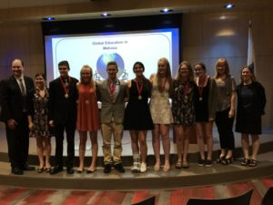 Teachers Michael Noone and Suzanne Troy alongside award-winning students James Talbot, Holly Moore, Lucien Carbonneau, Isabel Castro, Emma Bates, Helen Burtnett, Lauren Reilly, and fellow teachers Michelle Stepper and Denise Wagstaff at the Global Education in Melrose Celebration. (Courtesy Photo Melrose Public Schools)