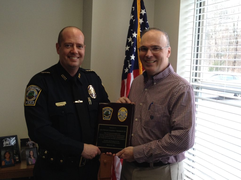 Chief Cudmore (left) congratulates retiring Lieutenant David F. Thomson III. (Georgetown Police Courtesy Photo)