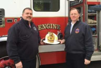 Deputy Fire Chief Rusty Ricker, left, welcomed new Chief Fred A. Mitchell Jr., right, to the Georgetown Fire Department on Oct. 4. (Courtesy Photo)