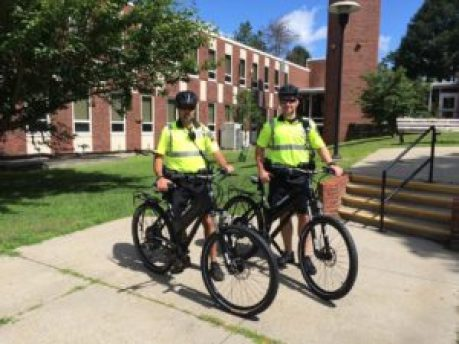 Officers Jeff Torrisi, left, and Nick Conway debut two new Polaris eBikes for the Methuen Police Department.