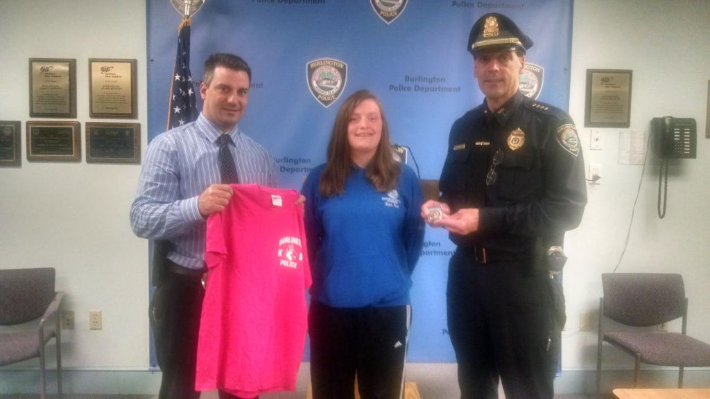 Pictured left-to-right are Burlington Police Detective Thomas Carlson, Merry Lapointe, and Burlington Police Chief Michael R. Kent. (Courtesy of the Burlington Police Department)