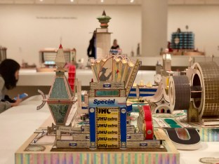Kimbembele Ihunga (1994) (Detail): A peek at Kingelez's construction methods. Toothpaste and glue stick boxes provide this sculpture with form and polychromy.
