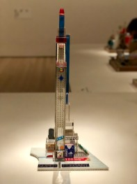 Nippon Tower (2005): Here, Kingelez's use of transparent materials and fine linework gives this sculpture an architectural verisimilitude. As with his other projects, pieces of advertisements and images cut out from a Cata brand energy saving bulb box gives this sculpture its definite form.