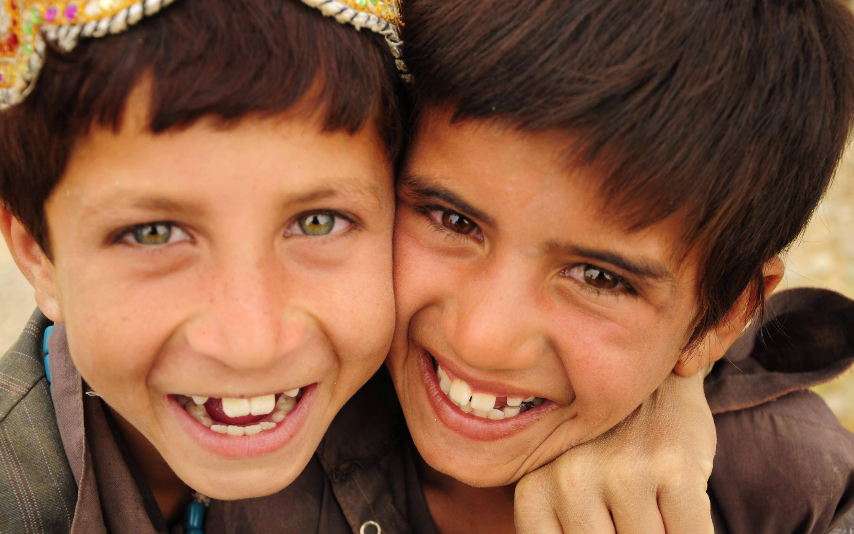 Afghan boys smiling, adoption foster care family, adoption photographer