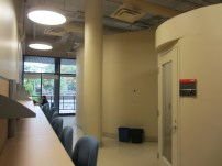 The study space lining the back wall and the private phone call room, photo by Erica Howes.
