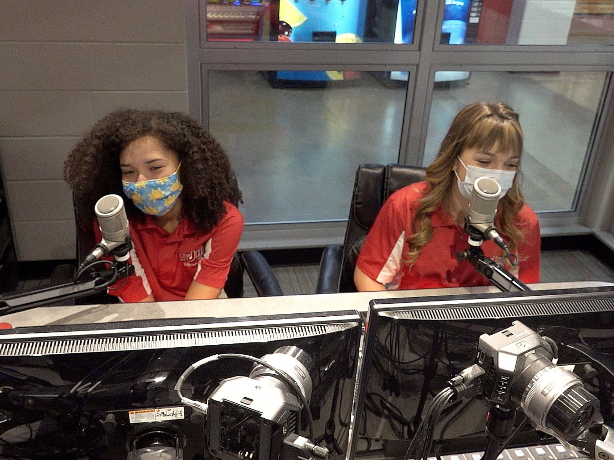 Two girls broadcasting from the radio and TV station