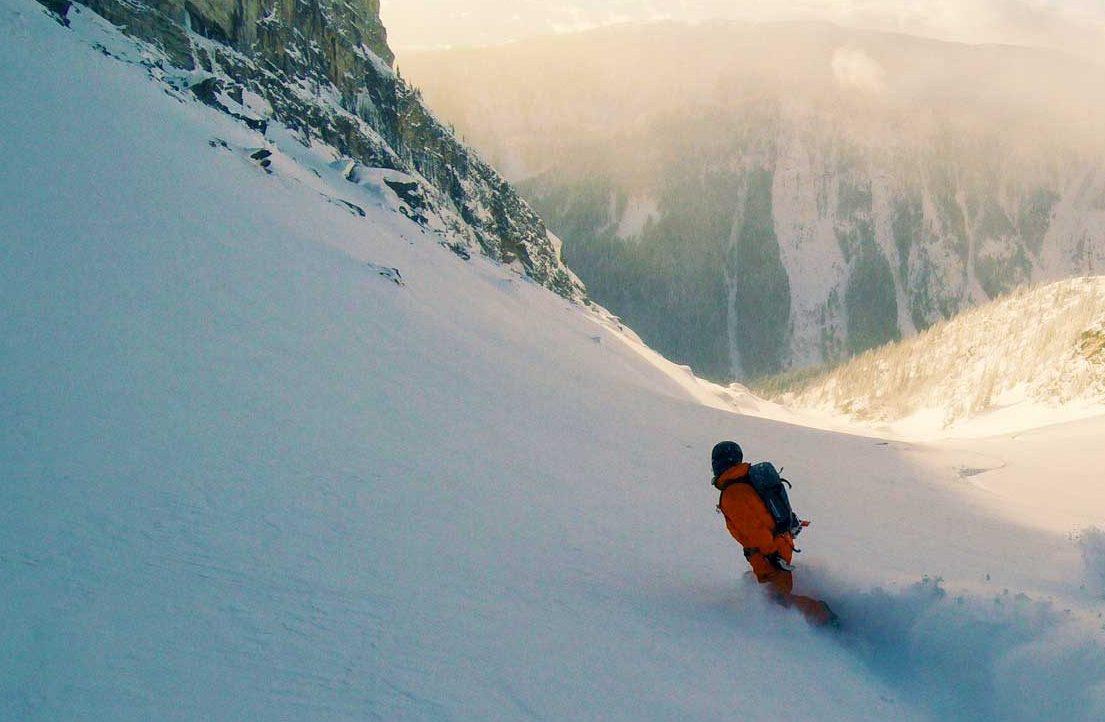 Blake Mycoskie snowboarding in the backcountry