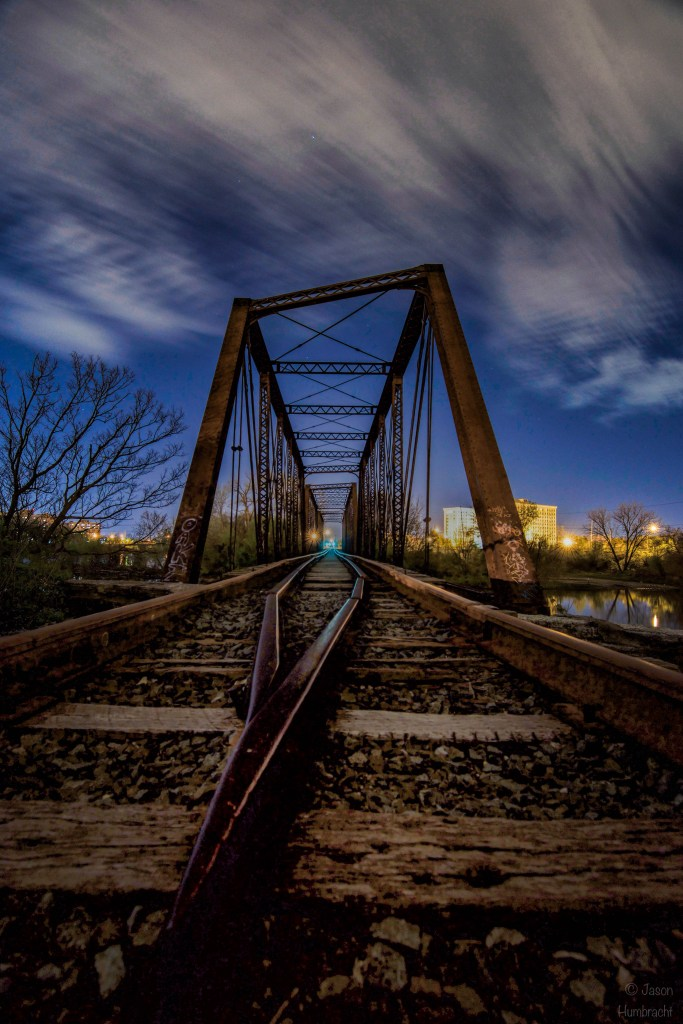 Indianapolis at Night | Indianapolis Nightscapes | Indianapolis Architecture | Train Bridge | Image By Indiana Architectural Photographer Jason Humbracht