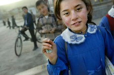 A Kurdish schoolgirl walks home from school March 5, 2003, in Cizre, Turkey. Chris Hondros/Getty Images