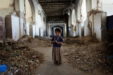 An Afghan girl stands in the ruins of Darul Aman Palace on the outskirts of Kabul, Oct. 21, 2010. Chris Hondros/Getty Images