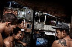 Young men watch soccer on a rooftop in the Rocinha favela, or slum, in Rio de Janeiro, Brazil, in April 2007. Balazs Gardi