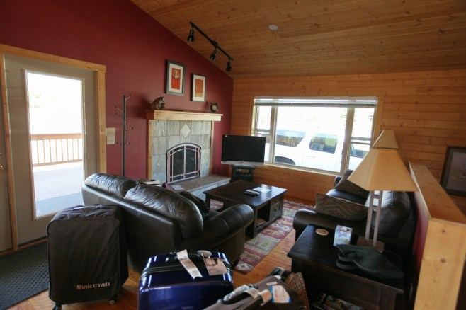 The nice living room by the kitchen. There's also a fireplace as well.