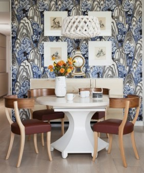 An upholstered wall adds softness and character to the dining room