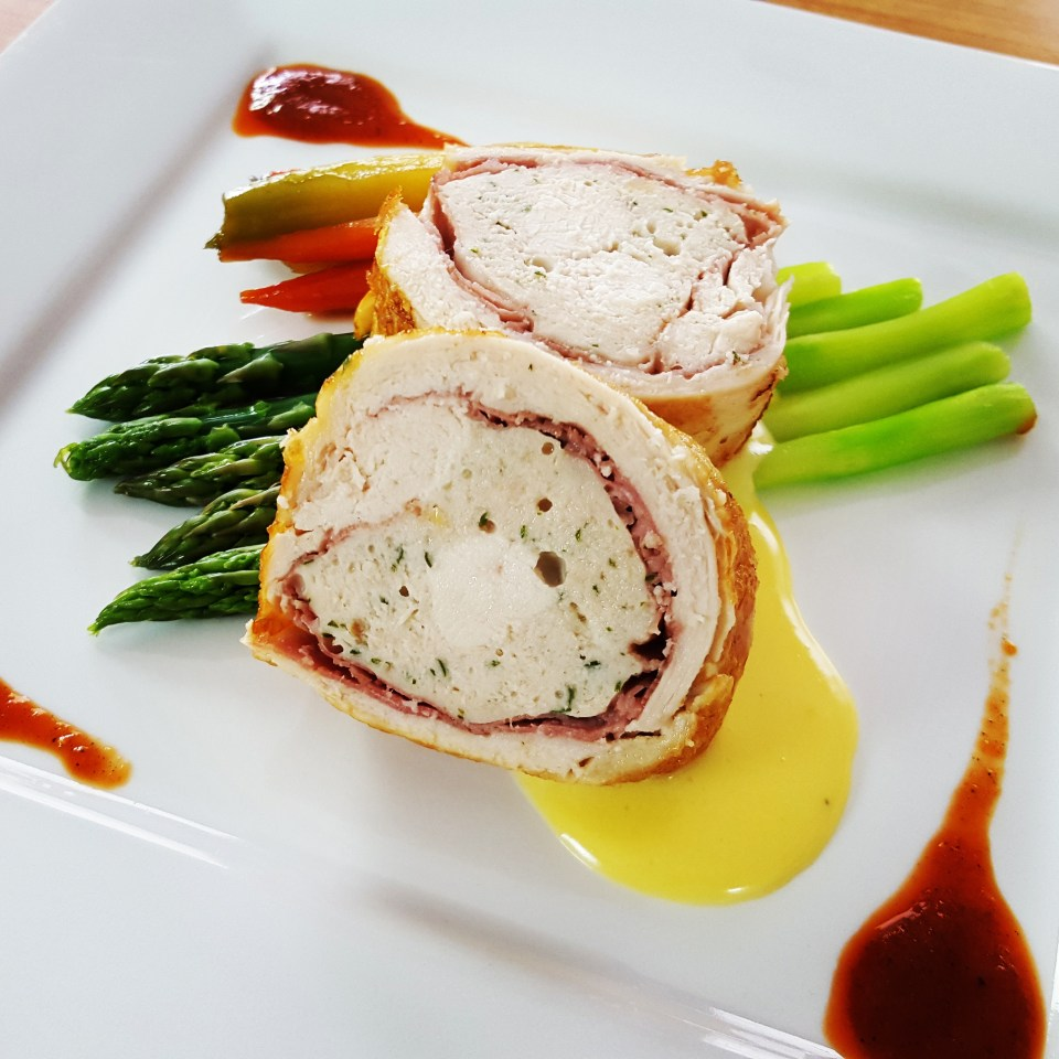Chicken Roulade asparagus, hollandaise, glazed carrots, roasted red pepper coulis