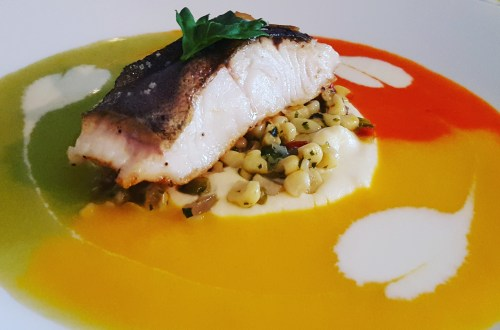 Black Cod with Celery Root Puree, Corn Relish, and Tri-Color Bell Pepper Sauces