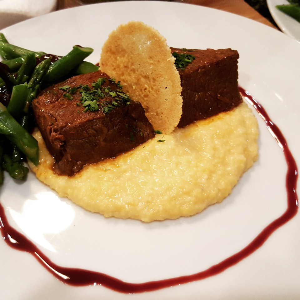 Red Wine Tomato Braised Short Ribs Parmesan polenta, asparagus, parmesan frico, beurre rouge