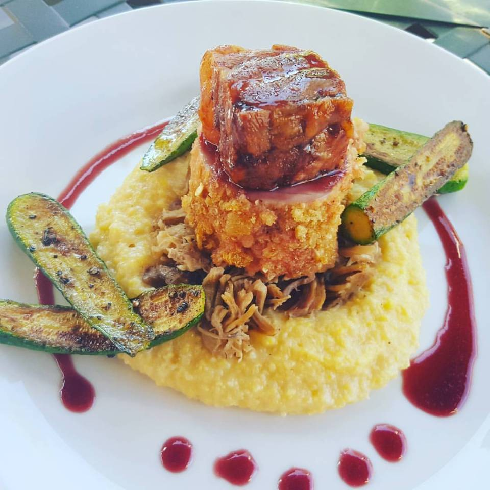 Trio of Pork- shredded pork shoulder, chicharonnes crusted tenderloin & pork belly with polenta and cherry gastrique