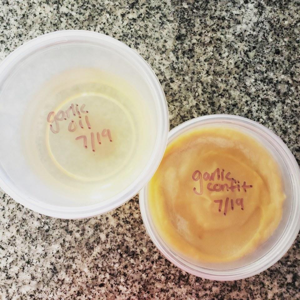 garlic confit and garlic oil in deli cups