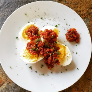Hard boiled eggs with sun dried tomato relish