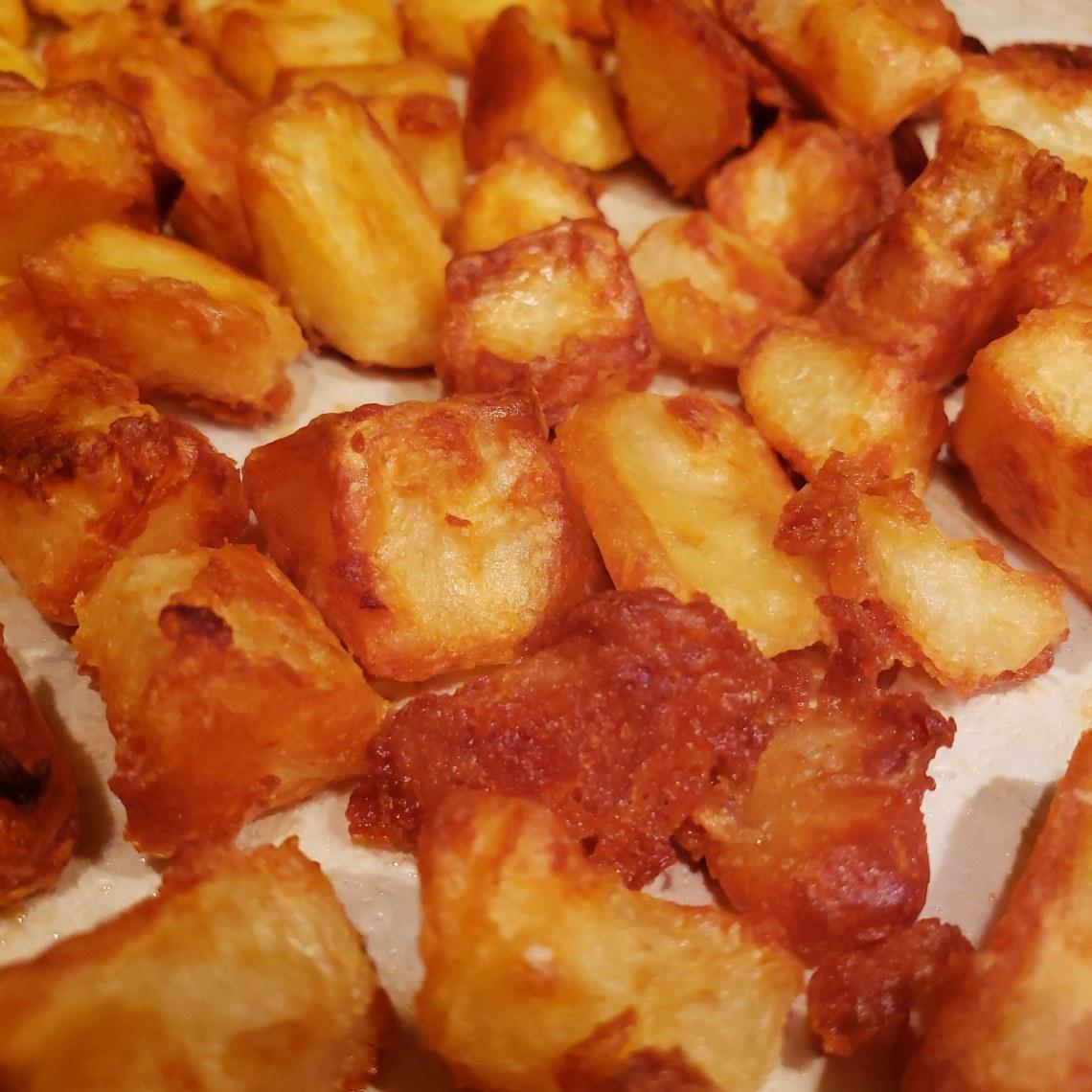 Close up of super crispy oven roasted potatoes