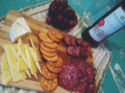 Cheeseboard with the family: crackers, mature cheddar, brie, Italian salami, German sausages, grapes & really good moscato