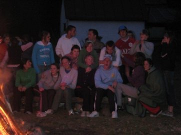 By the bonfire in the mountains.