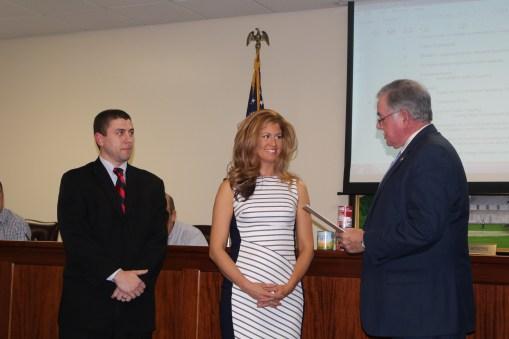 Jill receiving award for her newspaper column