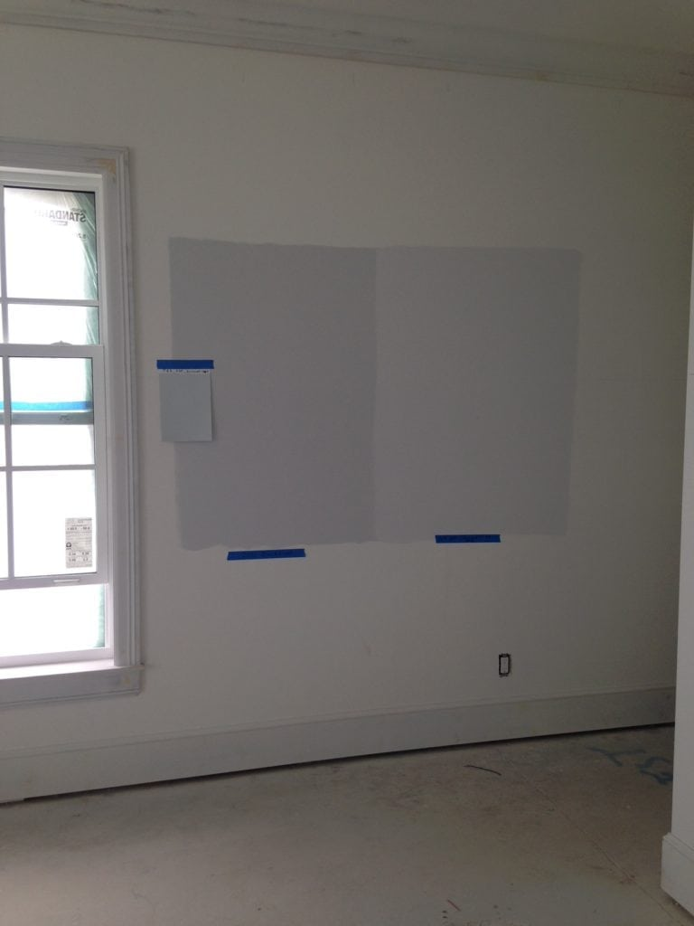 paint color samples on the wall of a guest bedroom jill shevlin design vero beach interior designer