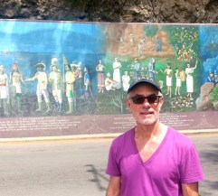 Blogger in front of the mural.