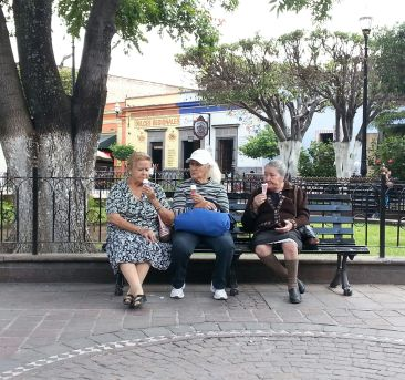 Three Mexican ladies and their ice cream in Tlaquepaque.