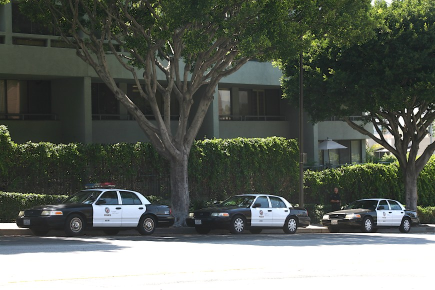 Police cruisers parked along 1st street and Hope street in Los Angeles