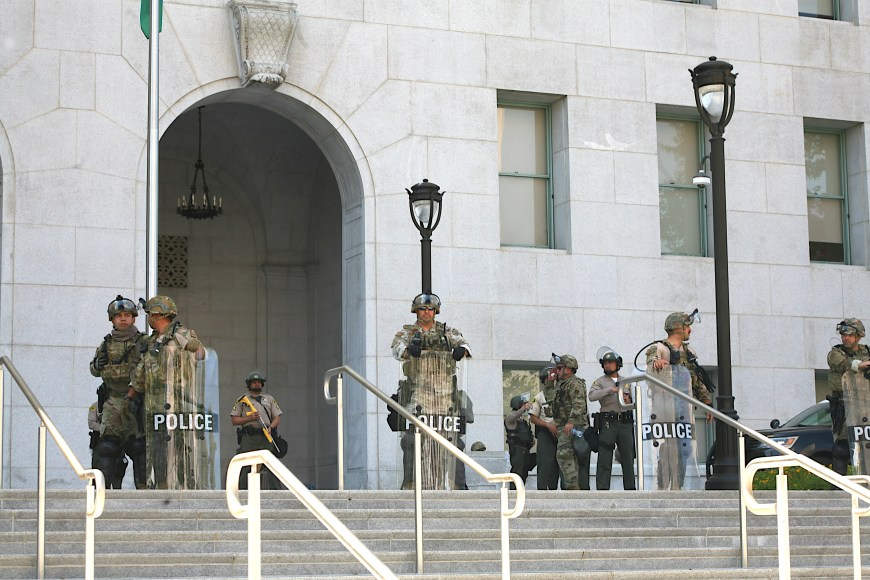 A group of police officers, sheriffs, and National Guard service-members at the Hall of Justice in downtown Los Angeles