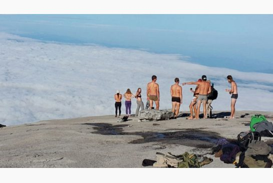 Young people on the top of Mt. Kinabalu in Malaysia, apparently just before some stripped naked for a photo.