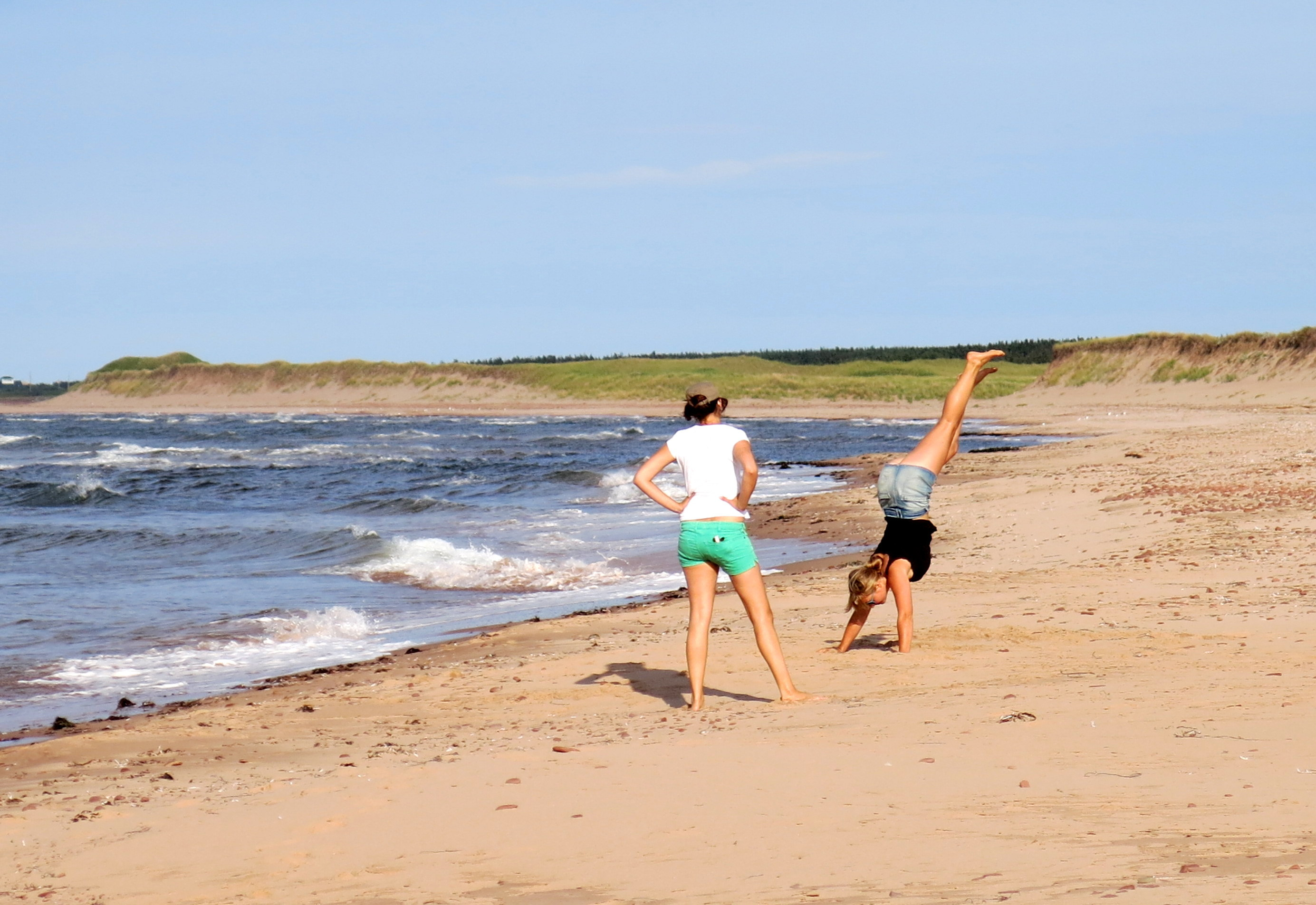Talk about enjoying a beach. I snapped this of a couple of German visitors on the beach in Greenwich in Prince Edward Island National Park.
