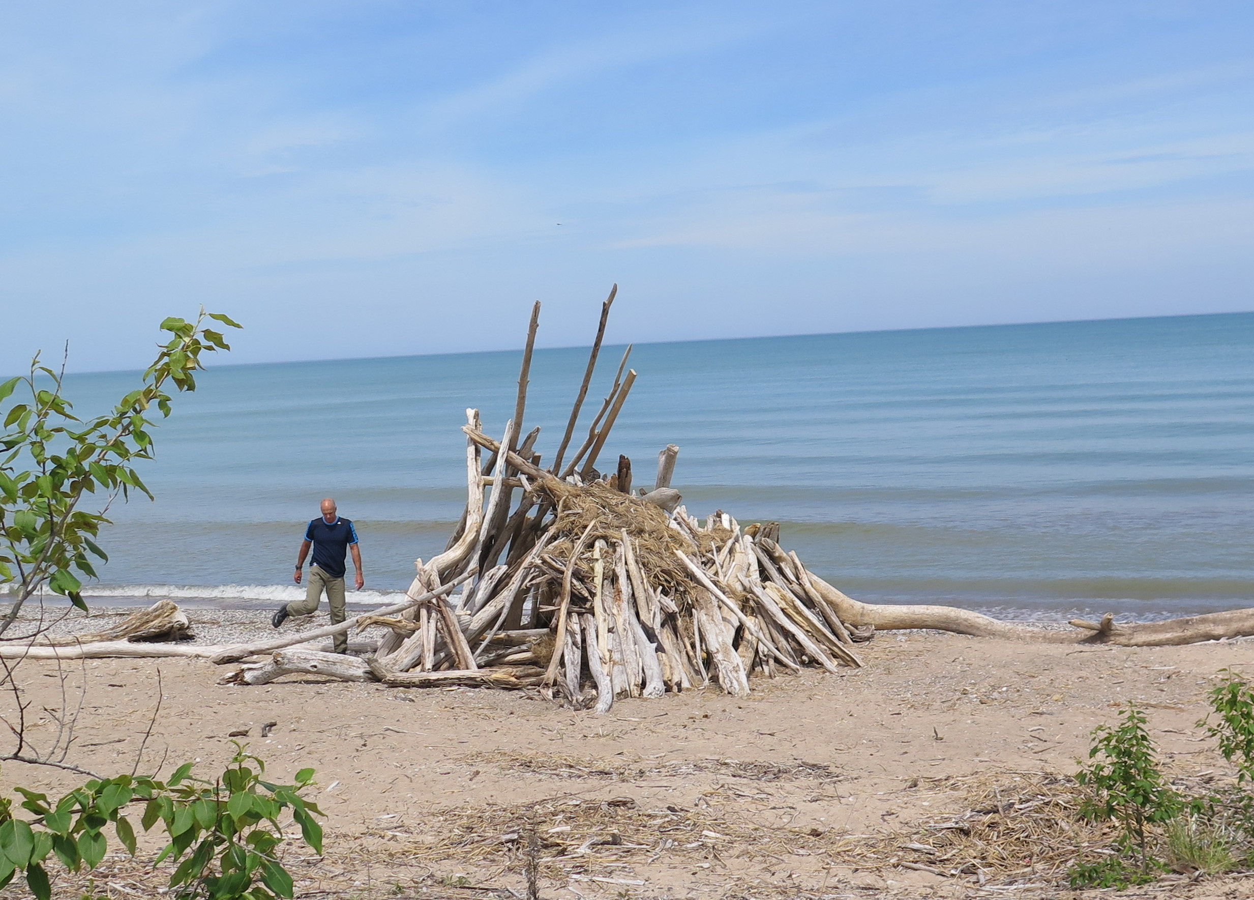 "Building a driftwood ""teepee"" on the shores of Lake Huron at The Pinery Provincial Park. JIM BYERS PHOTO"