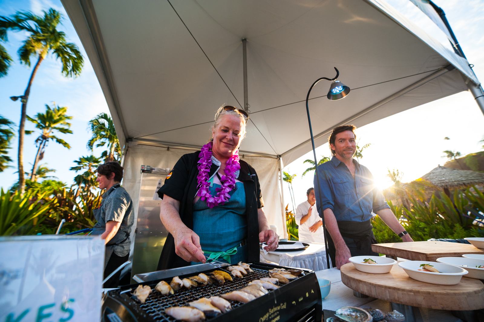San Francisco chef Nancy Oakes grills local abalone at the Hawaii Food and Wine Festival on Maui.