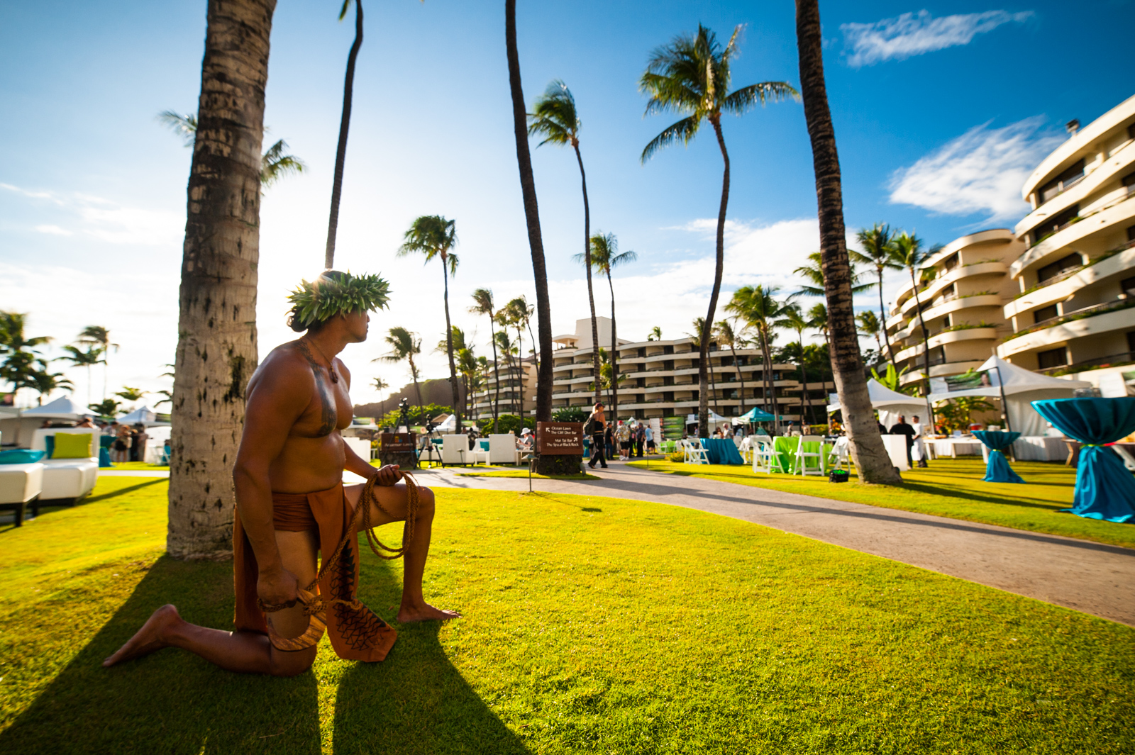 A man dressed in native Hawaiian garb takes in the Hawaii Food and Wine Festival at the Sheraton Maui on Ka'anapali Beach.