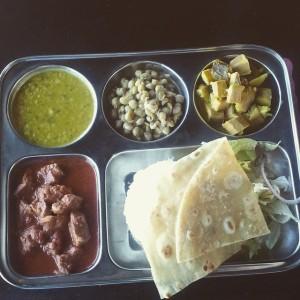 LUNCH: Pork vindaloo, rice, yellow dal, peas, green bananas, dalad and naan.
