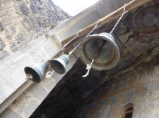 the cave city included 13 churches, some still in use today, here a decorated ceiling and church bells
