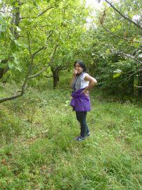 Khato eats an apple fresh off the tree