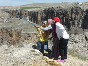 three Indonesian tourists taking a selfie