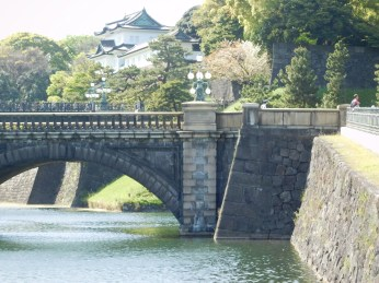 The bridge to the palace with an ancient guard house in the background.