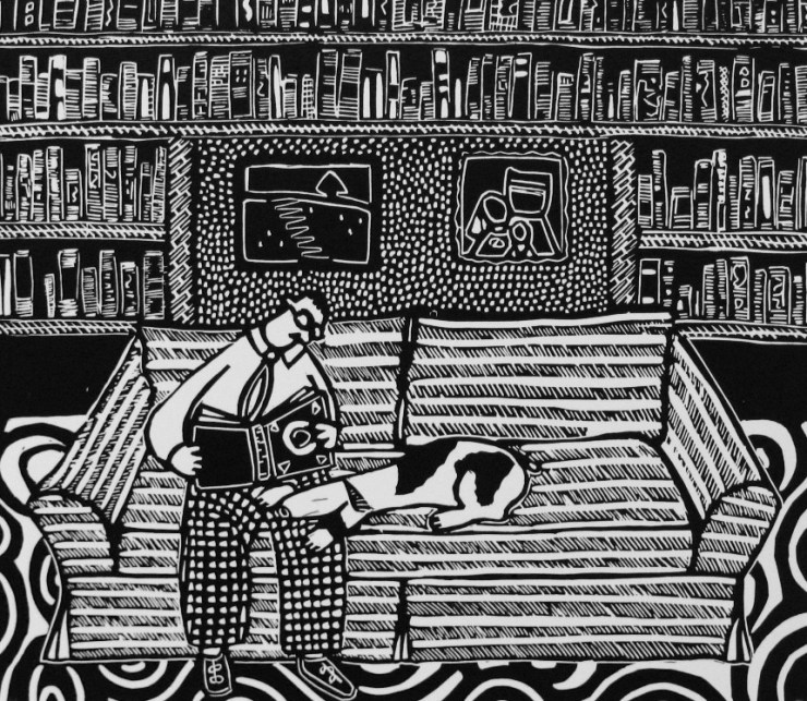 """Library"" by Coco Berkman (a black-and-white print of a man reading in his library with his dog)"
