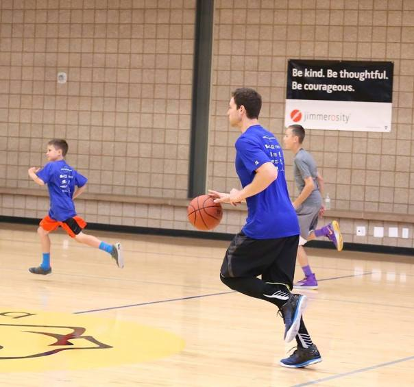 Jimmer teaching basketball and kindness to our youth.