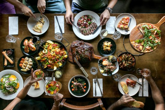 table of food, steak, grilling, Italian, Mexican, sharing food, smoking, cast iron