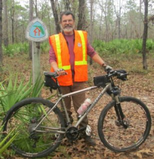 Jim-Schmid-with-mtn-bike-next-to-Florida-Trail-sign-at-Camel-Lake-Apalachicola-Nat-Forest-2014