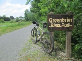 Jim-Schmid's-mtn-bike-next-to-trail-sign-Greenbrier-River-Trail-WV-06_21-to-24-2015
