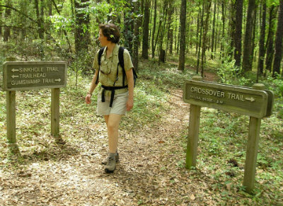 Sandra-Schmid-next-to-signs-at-Leon-Sinks-Geological-Area-Tallahassee-FL-2006